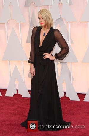 Margot Robbie - Hollywood's biggest stars were snapped on the red carpet as they arrived for the 87th Annual Oscars...