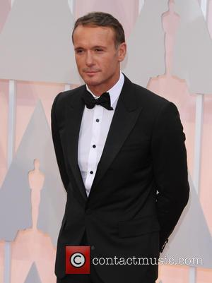 Tim McGraw - Hollywood's biggest stars were snapped on the red carpet as they arrived for the 87th Annual Oscars...