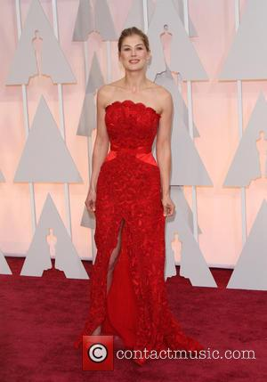 Rosamund Pike - Hollywood's biggest stars were snapped on the red carpet as they arrived for the 87th Annual Oscars...