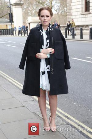 Tanya Burr - London Fashion Week Autumn/Winter 2015 Issa - Outside Arrivals at London Fashion Week - London, United Kingdom...