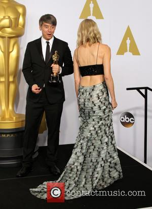 Naomi Watts and Tom Cross - 87th Annual Academy Awards held at The Dolby Theatre - Press Room at Dolby...