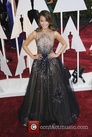 Jamie Chung - Hollywood's biggest stars were snapped on the red carpet as they arrived for the 87th Annual Oscars...
