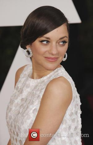 Marion Cotillard - Hollywood's biggest stars were snapped on the red carpet as they arrived for the 87th Annual Oscars...
