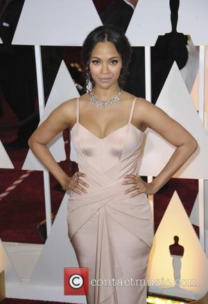 Zoe Saldana - Hollywood's biggest stars were snapped on the red carpet as they arrived for the 87th Annual Oscars...