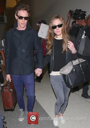Shots of the Oscar winning actor Eddie Redmayne  along with his wife as they arrived in to Los Angeles...