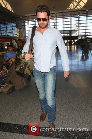 Scottish Hollywood actor Gerard Butler was spotted as he arrived in to Los Angeles International Airport in Los Angeles, California,...