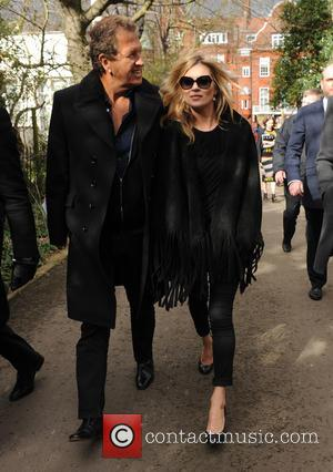 Kate Moss Clashes With Paparazzo Outside Paris Club With Lady Gaga