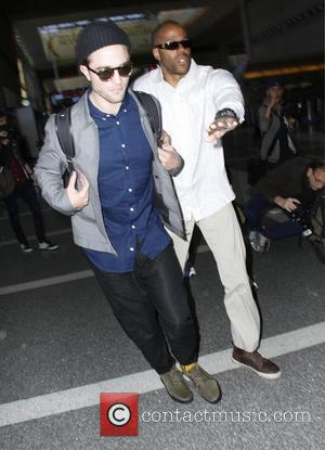 British actor and star of the Twilight films Robert Pattinson was photographed as he rushed through the entrance to Los...