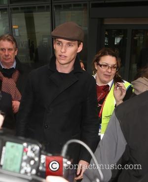 Eddie Redmayne - Eddie Redmayne and wife Hannah Bagshawe, Orlando Bloom and Mark Ronson arrive at Heathrow Airport - London,...