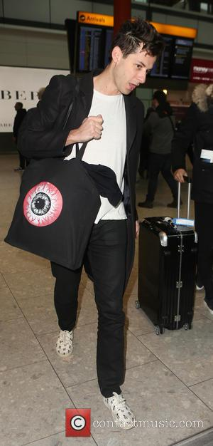 Mark Ronson - Eddie Redmayne and wife Hannah Bagshawe, Orlando Bloom and Mark Ronson arrive at Heathrow Airport - London,...
