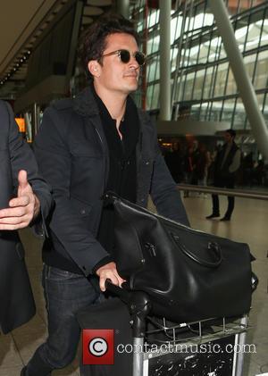 Orlando Bloom - Eddie Redmayne and wife Hannah Bagshawe, Orlando Bloom and Mark Ronson arrive at Heathrow Airport - London,...