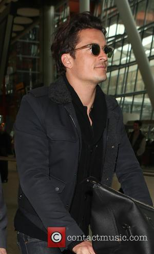 Orlando Bloom - Eddie Redmayne and wife Hannah Bagshawe, Orlando Bloom and Mark Ronson arrive at Heathrow Airport - London,...