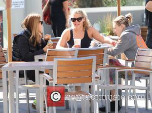 Busy Philipps - Cougar Town actress Busy Philipps having a laugh spending time having a coffee and a chat with...