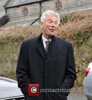 Adam Clayton - The Funeral of Rev.Jack Heaslip at St.Mary's Church Howth. Rev.Heaslip was U2's chaplin and travelled around the...