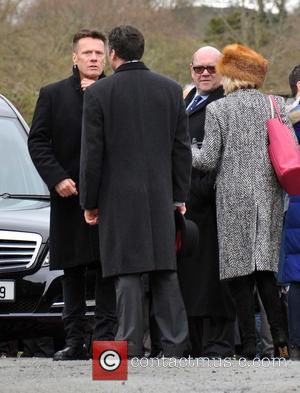 Larry Mullen Jr. and Paul McGuinness - The Funeral of Rev.Jack Heaslip at St.Mary's Church Howth. Rev.Heaslip was U2's chaplin...