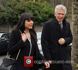 Mariana Teixeira de Carvalho and Adam Clayton