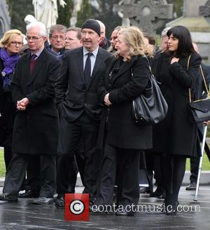 The Edge - The Funeral of Rev.Jack Heaslip at St.Mary's Church Howth. Rev.Heaslip was U2's chaplin and travelled around the...