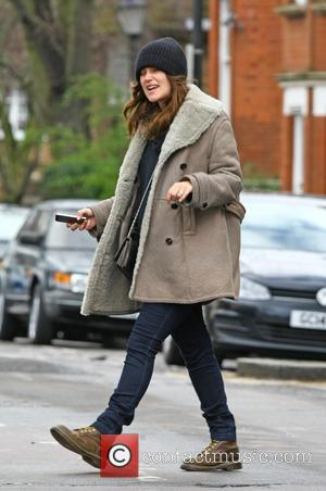 Keira Knightley - Pregnant Keira Knightley and her husband James Righton take a walk to a dry cleaners in London...