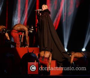 Madonna Falls Off Brits Stage,