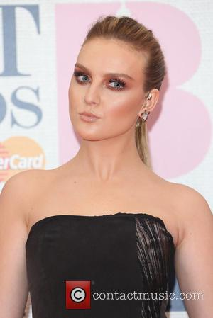 Perrie Edwards and Little Mix - A variety of stars from the music industry were photographed as they arrived at...