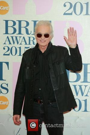 Jimmy Page Defeats Robbie Williams In Building Dispute