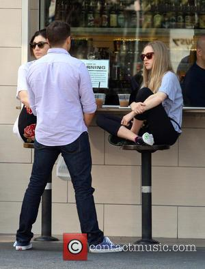 Amanda Seyfried - Amanda Seyfried having lunch with friends in Los Feliz and having a drink perched crossed legged on...