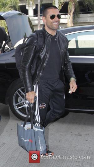 Mark Consuelos - Mark Consuelos departs from Los Angeles International Airport (LAX) - Los Angeles, California, United States - Thursday...