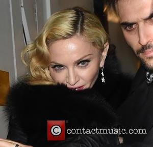 Madonna Shares Another Throwback Photo Of Son Rocco, As Custody Battle Continues