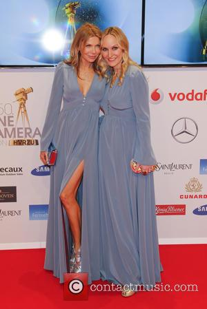 Ursula Karven and Anne Meyer-Minnemann - Shots of a host of stars as they arrive for the annual German Goldene...