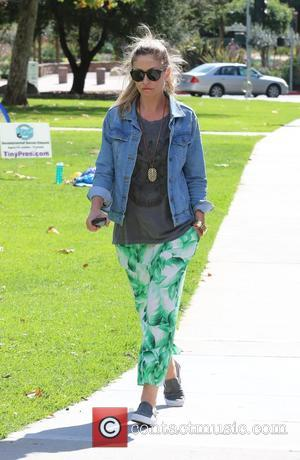 Rebecca Gayheart - Rebecca Gayheart stops by Coldwater Park and takes a walk holding her mobile phone, while her daughter...