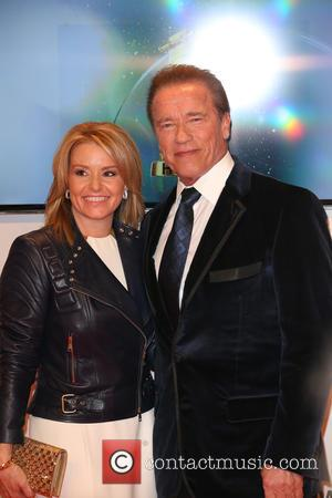 Arnold Schwarzenegger and Heather Milligan - Shots of a host of stars as they arrive for the annual German Goldene...