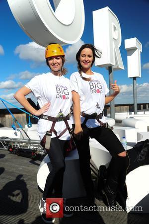 Beth Sherburn and Francesca Newman-Young - Francesca Newman-Young and Beth Sherburn abseil down Fort Dunlop for Claires Big Drop Comic...