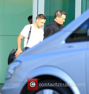 Liam Payne - One Direction arrive back in London from their world tour in Tokyo - London, United Kingdom -...