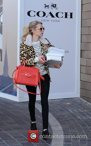 Emma Roberts - Emma Roberts out shopping at The Grove with a bright red handbag - Los Angeles, United States...