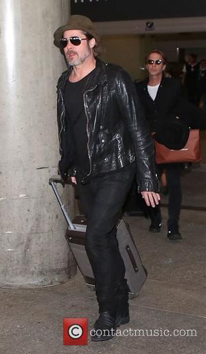 Brad Pitt - Brad Pitt arrives at Los Angeles International Airport (LAX) - Los Angeles, California, United States - Friday...