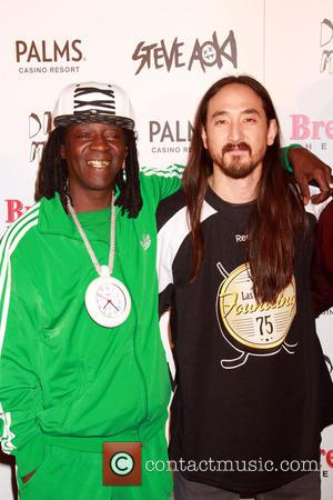 Flavor Flav and Steve Aoki - DJ/Producer Steve Aoki receives the