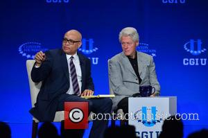 Larry Wilmore and Former U.s. President Bill Clinton
