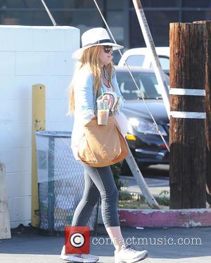 Shots of Australian actress and currently pregnant Isla Fisher as she takes a walk out in Studio City while wearing...