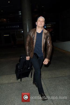 Jeremy Renner - Jeremy Renner arrives at LAX airport at LAX - Los Angeles, California, United States - Saturday 7th...