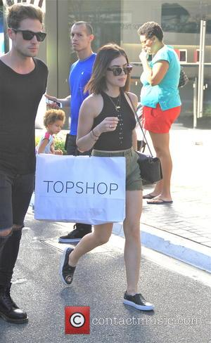 Lucy Hale and Adam Pitts - Lucy Hale and her boyfriend Adam Pitts carrying Topshop bags while shopping in the...
