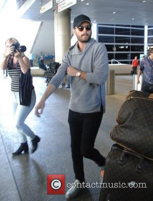 Scott Disick - Scott Disick arrives at LAX alone at LAX - Los Angeles, California, United States - Sunday 8th...