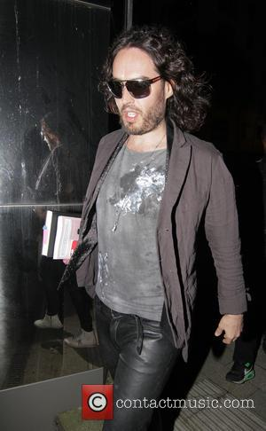 British comedian Russell Brand was snapped as he arrived at The Proud Archivist cafe for his 'Trews Musings' show for...