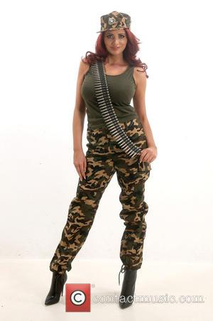 Amy Childs - Amy Childs wears full military gear during a studio shoot - Southend, United Kingdom - Monday 9th...