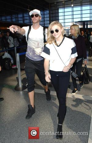 Chloe Grace Moretz and Trevor Moretz - Chloe Moretz departs from Los Angeles International Airport (LAX) with her 6 ft...