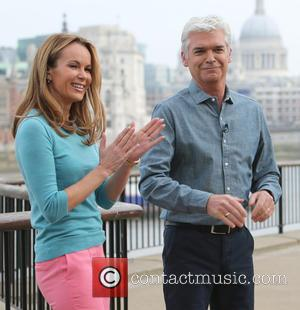 Amanda Holden and Phillip Schofield - Amanda Holden filming for This Morning Show on the Southbank - London, United Kingdom...
