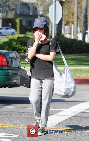 Lucy Hale - Lucy Hale out and about in Los Angeles wearing tracksuit pants, a cap and sunglasses - Los...