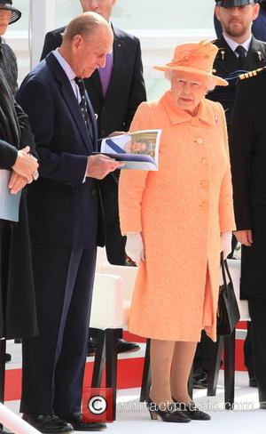 Shots of Queen Elizabeth II and her husband the Duke of Edinburgh at the naming ceremony of a new cruise...