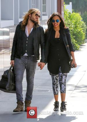 Zoe Saldana and Marco Perego - Zoe Saldana and her husband Marco go to an office center - Santa Monica,...