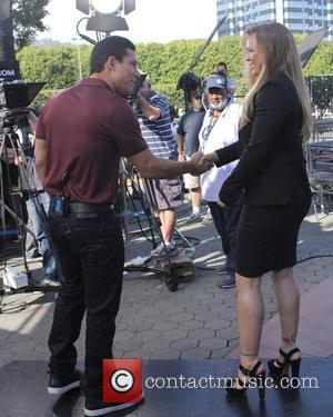 Mario Lopez and Ronda Rousey - Celebrities appear for interview on entertainment show Extra at Universal City Walk - Los...
