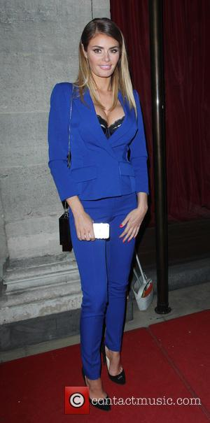Chloe Sims - Tric Awards 2015 held at the Grosvenor House hotel - Arrivals at Grosvenor House - London, United...